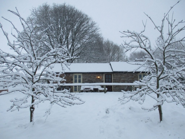 Cottage in the heavy snow, still cosy inside with central heating