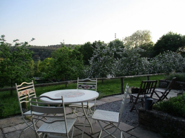 Enjoy meals outside on the south facing terrace, overlooking the orchard
