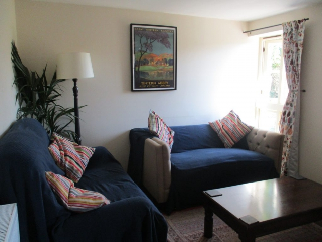 The cottage living room seats four in comfortable sofas and has a TV and DVD player.